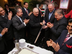 Nuncio Alberto Bottari de Castello, Dean of the Diplomatic Corps; Hungary's Deputy Minister of Foreign Affairs and Trade László Szabó and Ambassador Lounes Magramane cut the cake with a sword.