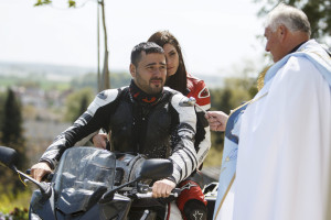 Priest blesses riders at the beginning of the biking season