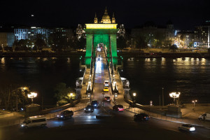 The Chain Bridge lit with Brazilian national colours 100 days before the start of the Olympics