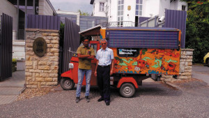 Ambassador Rahul Chhabra (right) outside the Indian Embassy in Budapest with Naveen Rabelli, the inventor, builder and driver of his electric tuk-tuk