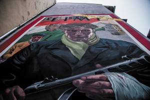 """A mural of the 1956 """"Man of the year: Hungarian patriot"""" edition of Time magazine in Wesselényi utca"""