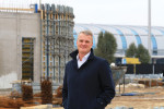 Budapest Airport's Property Director René Droese at the hotel construction site in front of SkyCourt at Terminal 2