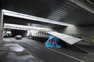 Trucker ignores height limit, crashes into overpass in District X